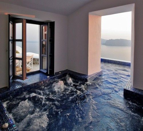 Hot tub that goes from indoors to outdoors