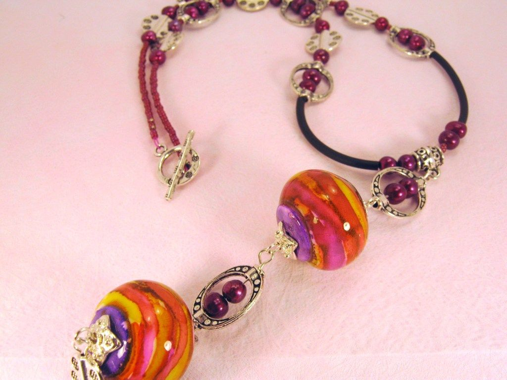 Funky, bright alcohol ink beads turned into boho/gypsy style necklace.
