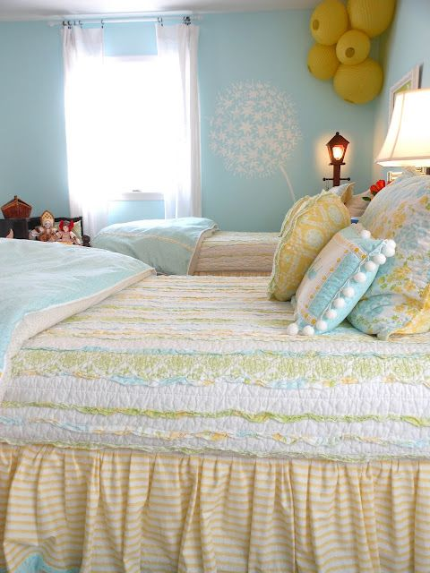 gorgeous set of twin beds with pretty light bright happy bedding
