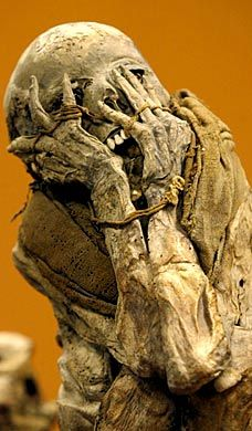This is one of the most intense images I have seen, a mummified woman cowering and covering her face, contorted in terror over whatever she faced 600 years ago.