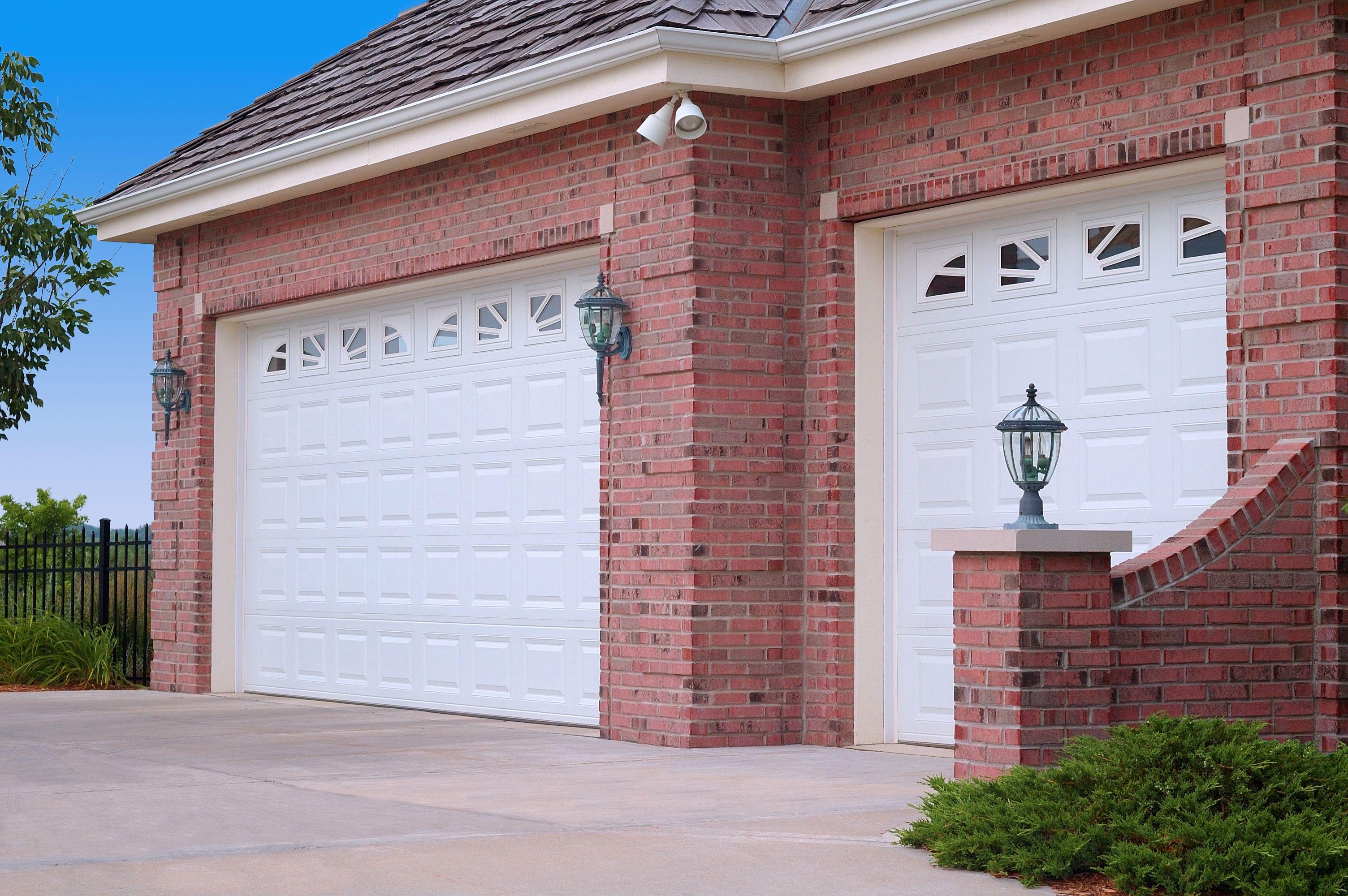 Insulated Steel Garage Doors With Sunburst Window Designs By C.H.I.  Overhead Doors.