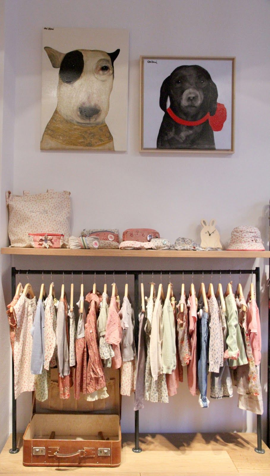 Love this dog art and using an open speed rail for clothing storage