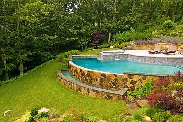 Sloped backyard pool ideas home pinterest sloped for Cost of building on a steep slope