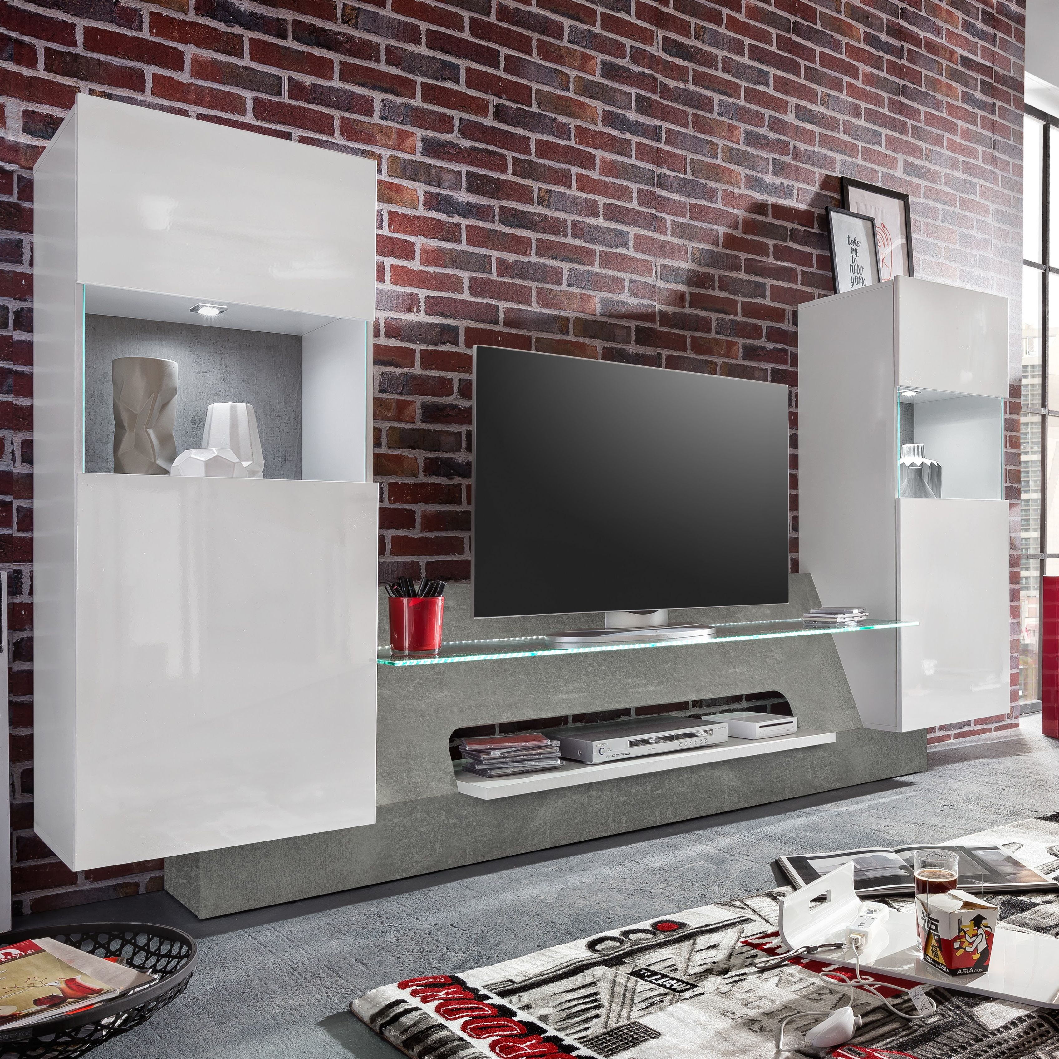 diese moderne tv wand mit wei gl nzenden fronten und betonoptik ist die ideale komplettl sung. Black Bedroom Furniture Sets. Home Design Ideas