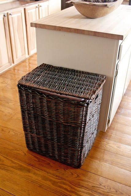trash cans kitchen sink island 8 sneaky ways to hide an ugly can cleaning organization simply drop your bin into a wicker hamper for vessel that adds bit more style in