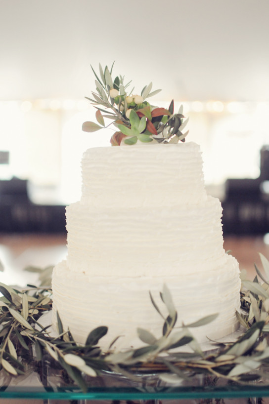 Tiered and textured white wedding cake with olive branches. #weddingcake #cakeideas #weddingchicks Captured By: Alea Moore Photography ---> http://www.weddingchicks.com/2014/04/29/family-farmhouse-wedding-retreat/