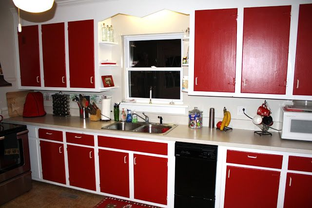 Brick red cabinets not this bright red in our large old for Bright red kitchen cabinets