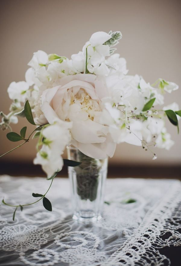 peony, white sweet peas, a sprig of white lavender, and trailing leaves. gorgeous