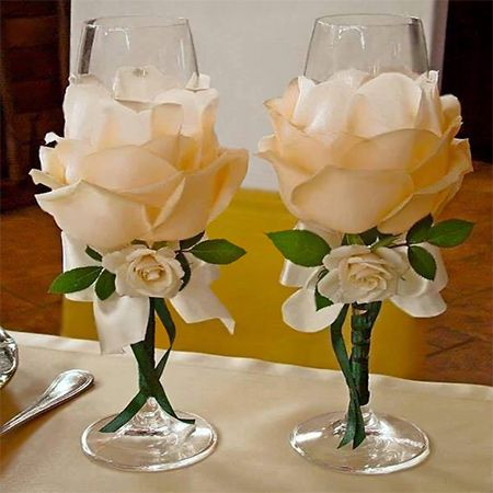 There are some really stunning silk flowers that you can buy, and we show you how to use silk flowers to dress up champagne glasses for a special occasion.