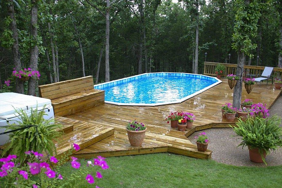 Decks for above ground pools this above ground oval pool for Above ground swimming pool deck designs