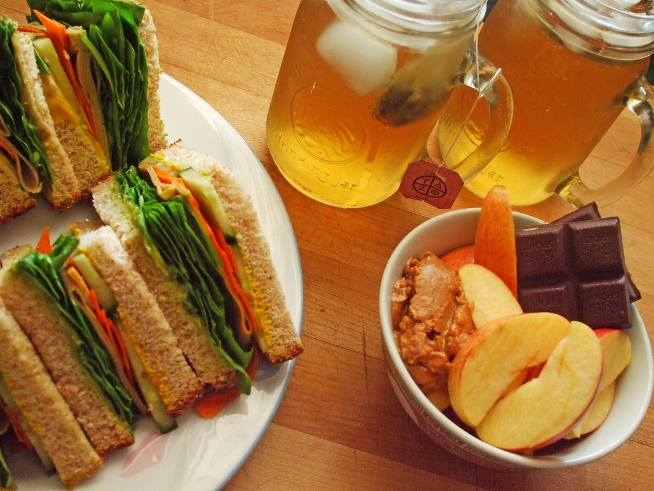 sandwiches on whole wheat bread with spinach, carrot