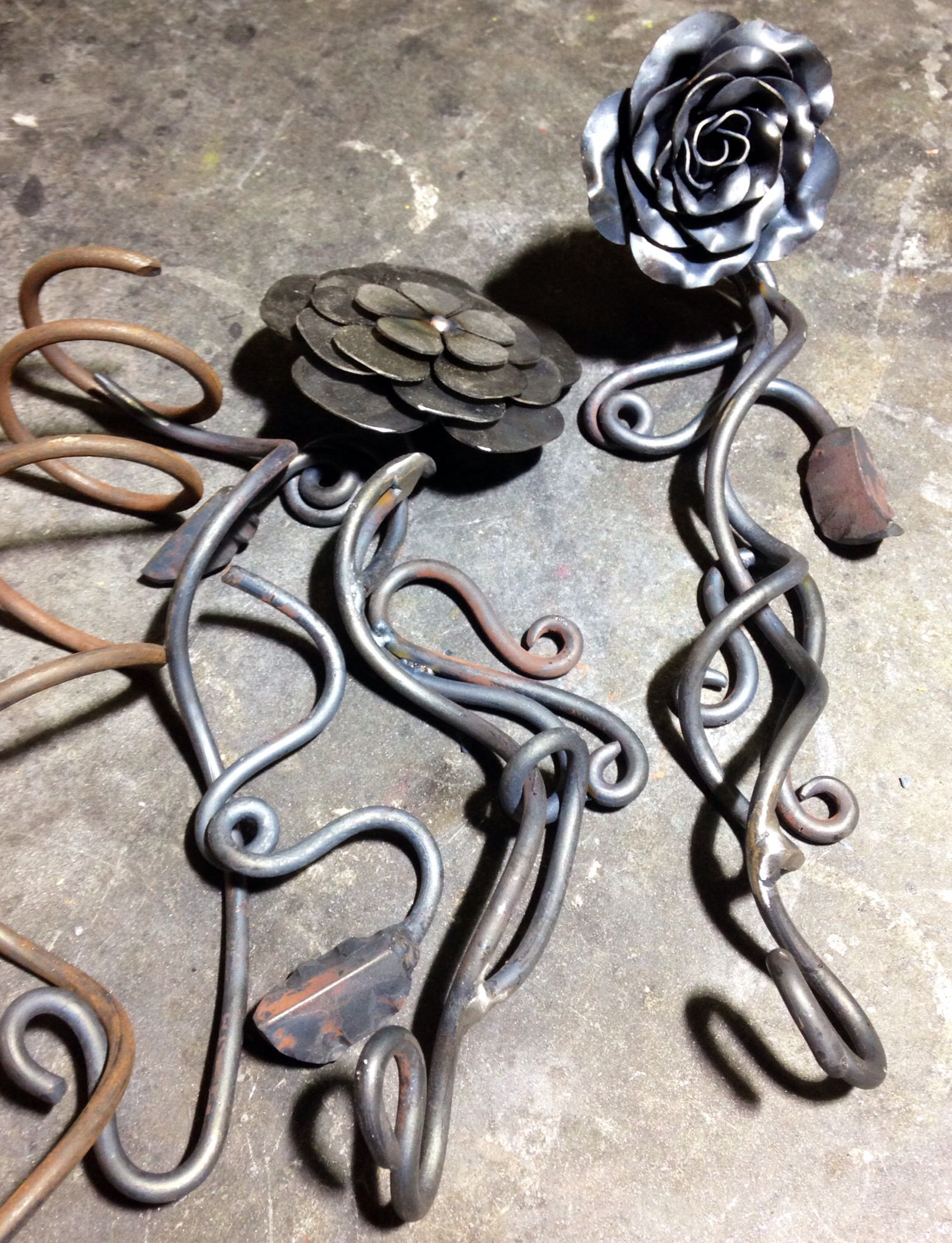 This Is The Order In How I Make My Steel Roses From Left To Right Spring Up Cycled Garage Doors Then Leaves Forged And Welded