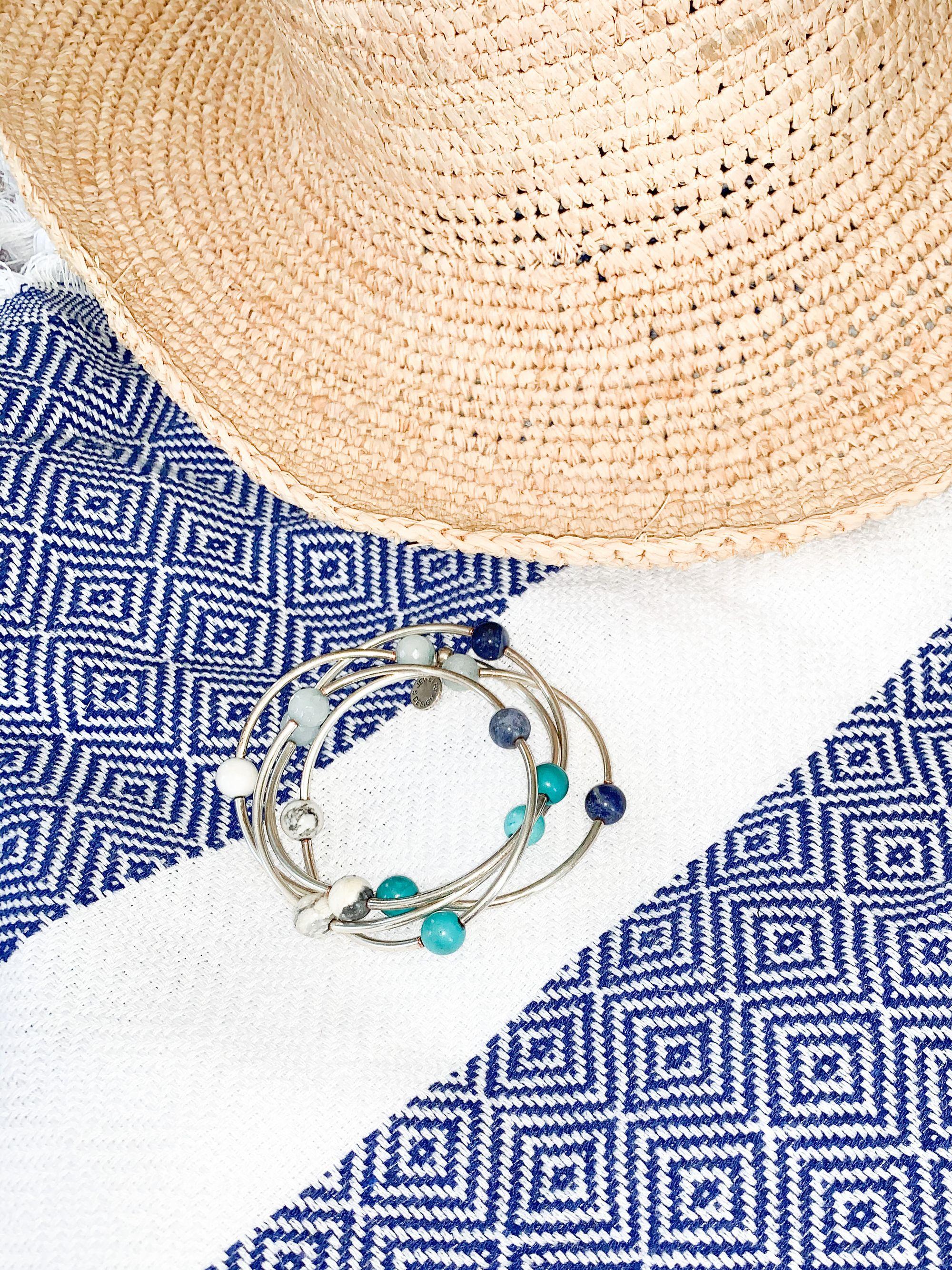 Beach bag essentials: sun hat, beach towel, coastal wrap, sunglasses, sunscreen, book, and a yummy snack. * * Featured Product: Coastal Stone Wrap . . . #sdesignjewelry#sdesign#staysavvy#girlboss#womenempoweringwomen#eachpurchaseemploysandempowers#usamade#naturalstones#empower#workingmoms#workingwomen#workingclass#workhardplayhard#feelgood#lookgood#beachbagessentials#sunhat#wrap#howlite#sodalite#turquoise#tiffanyblue#serenity#beachtowel#necklaceandwrap#sunscreen#beachseason#beachvibes#summer