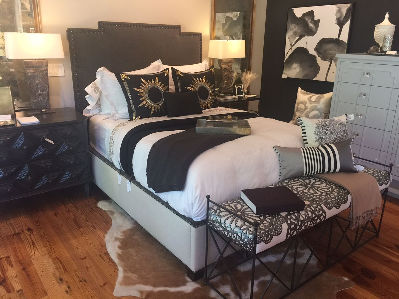 Custom upholstered bed with nailheads designed by Vivid