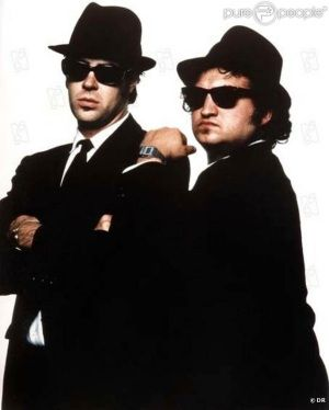 9cdeca3f6be One of my favorite celebrity sunglasses pictures. The blues brothers  wearing Ray Ban Wayfarer Sunglasses. So Coooooool!