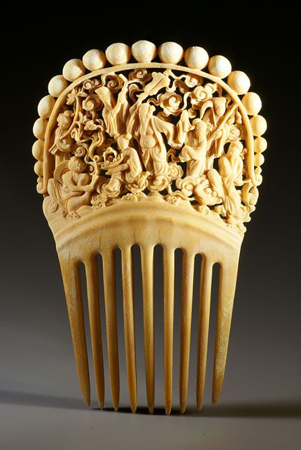 This impressive ivory comb features the eight Chinese Gods from the Dao Temple, home of Taoism. The artist portrayed the immortals crossing the sea. Respectively, they represent incarnations of the Chinese people: male, female, old, young, rich, noble, poor, and humble. Zhang Guolao's drum can augur life. Lu Dongbin's sword can subdue evil. Han Xingzi's flute can cause growth. He Xiangu's Water Lily can cultivate people through meditation. Tie Guaili's gourd can help the needy and relieve…