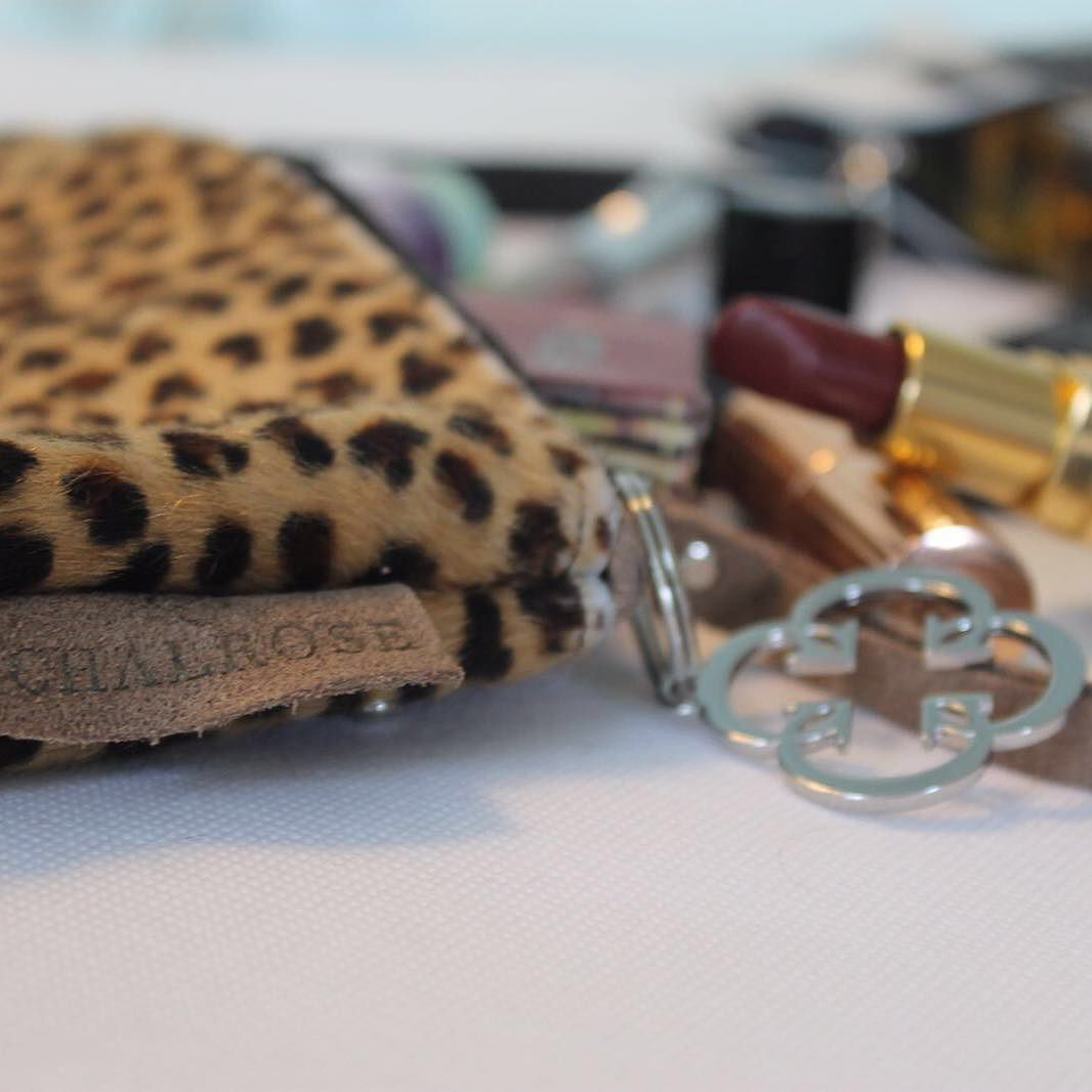 Show your wild side with one of our leopard-print Chalrose cosmetic bags!! Not only will it fit your makeup collection but it can also be 'clicked' to the front of your Chalrose bag for easy access to makeup for quick touch-ups!  #chalrose #handbag #makeupbag #cosmetics #fur #leopardprint #fashion