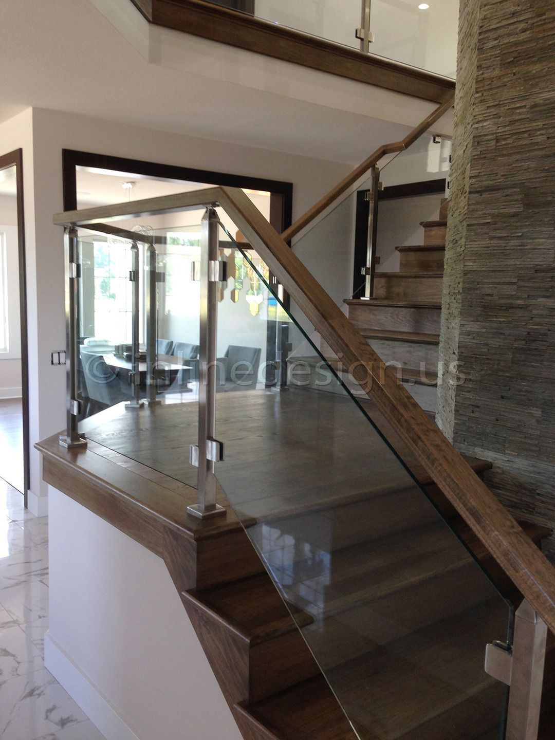 Glass balusters for railings single stainless steel for Interior glass railing designs