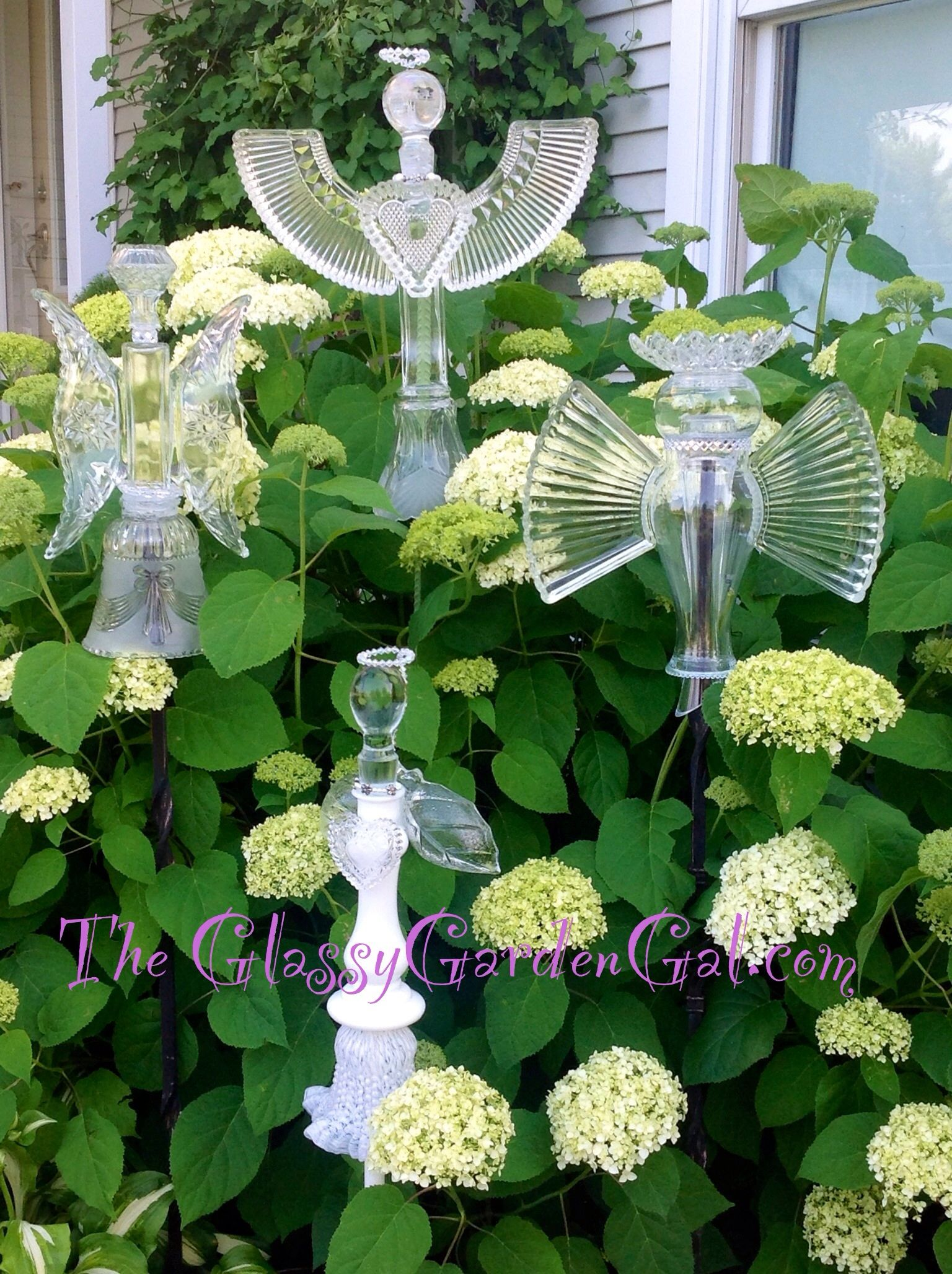 Hunt and gather crown point indiana garden totem glass for Recycled decorative items