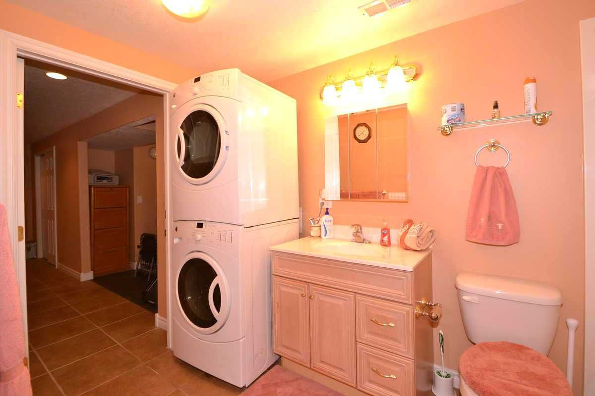Lower Level Laundry Room. For Sale: 6BD 3BA featuring a Lower Level 3BD Apartment! Contact Agent: Dorothy Bell Call/Text 801-493-9090 MLS# 1249942 56 Heron Ct., Saratoga Springs, UT 84045