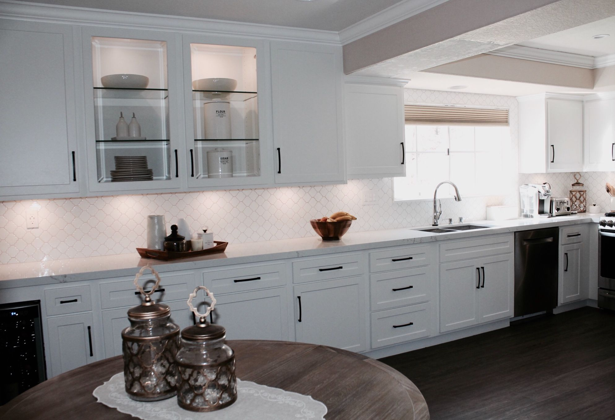 A Full Shot Of The Refaced Anaheim Kitchen This Is A Perfect Pallet To Follow When You Are Trying To Avoid Kitchen Cabinetry Kitchen Refacing Cabinet Remodel
