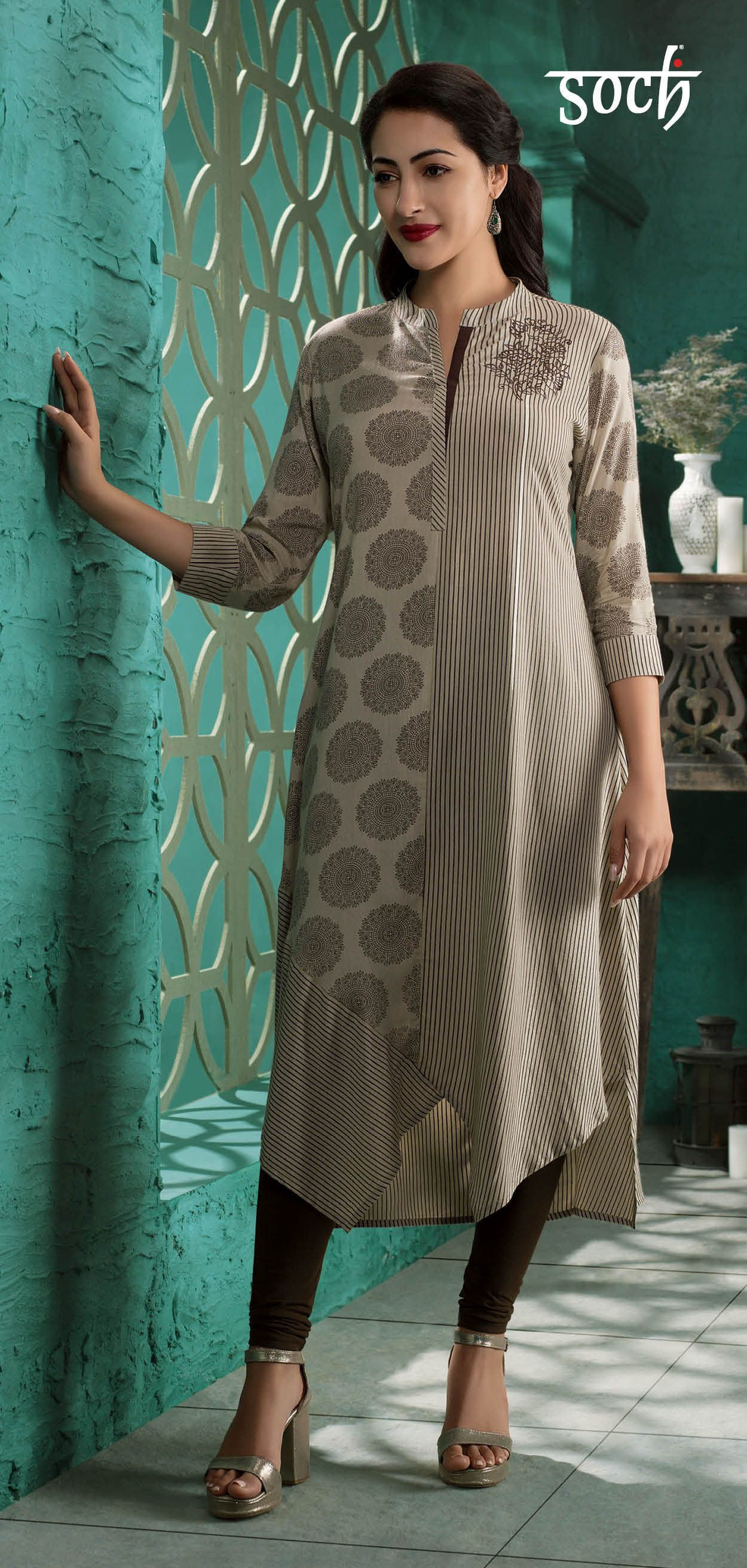 03491a2f5c Uniquely designed with ethnic motifs, this beige Soch kurti exudes style.  Tailored to perfection with rayon fabric in an A-line cut and 3/4th  sleeves, ...