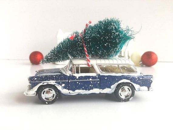 This classic blue car with a Christmas tree tied to the top is a vintage 1955 Chevy Nomad. Nothing says cozy like memories of a vibrant 1950s Christmas! Display this darling collectible car on the mantle, on a shelf, or in your Holiday guest bedroom. Keep one for yourself and gift one to a friend! If you are looking for a great gift for him these cars make a cute stocking stuffer! To see all of our unique Christmas decor click here: https://www.etsy.com/shop/UrbanTealLLC?r...