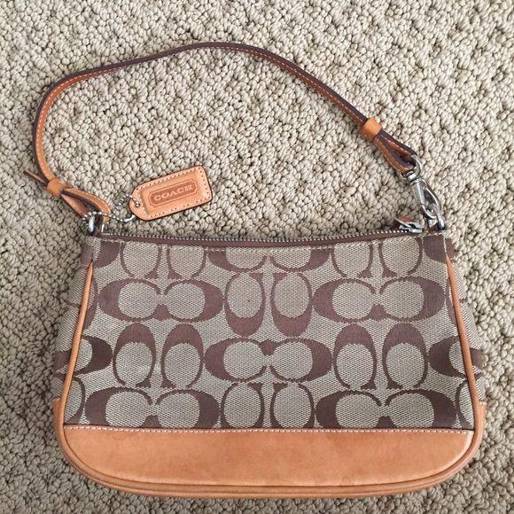 Classic coach handbag Small coach handbag. Shows some wear but still in great condition! Classic coach pattern. Coach Bags Mini Bags
