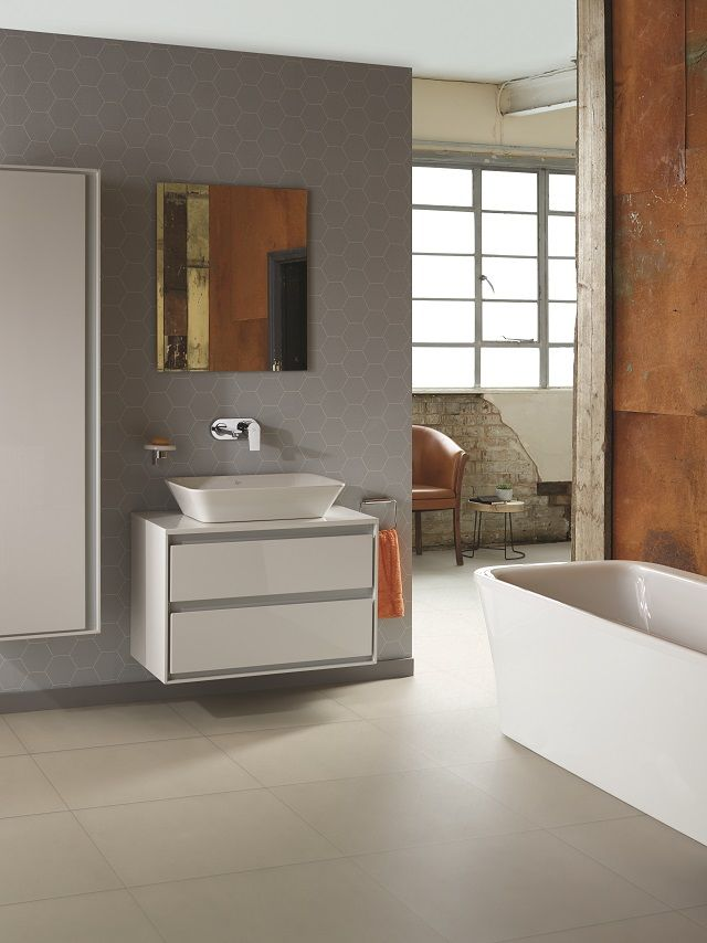 Ideal Standard bathroom featuring bath, basin and mirror