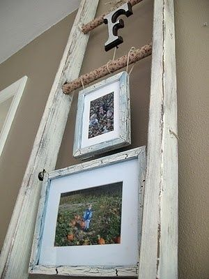 Use An Old Rustic Looking Ladder To Hang Frames And Other Family Mementos