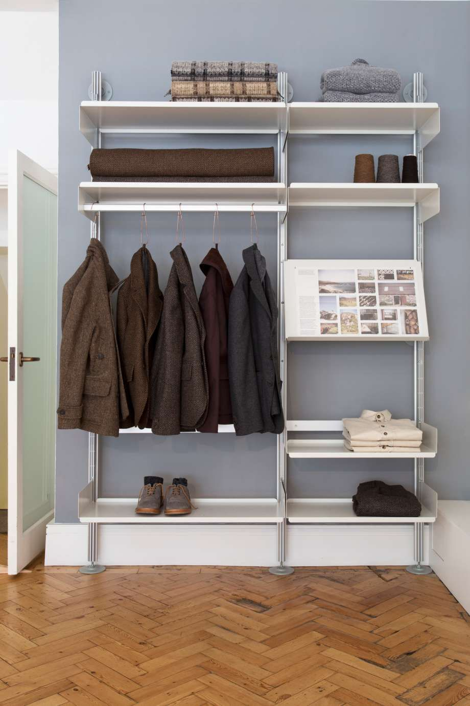 A Semi Wall Mounted Shelving System With Shelves And A Hanging Rail That Can Be Rearranged At Will Restaurant Shelving Shelving Systems Design