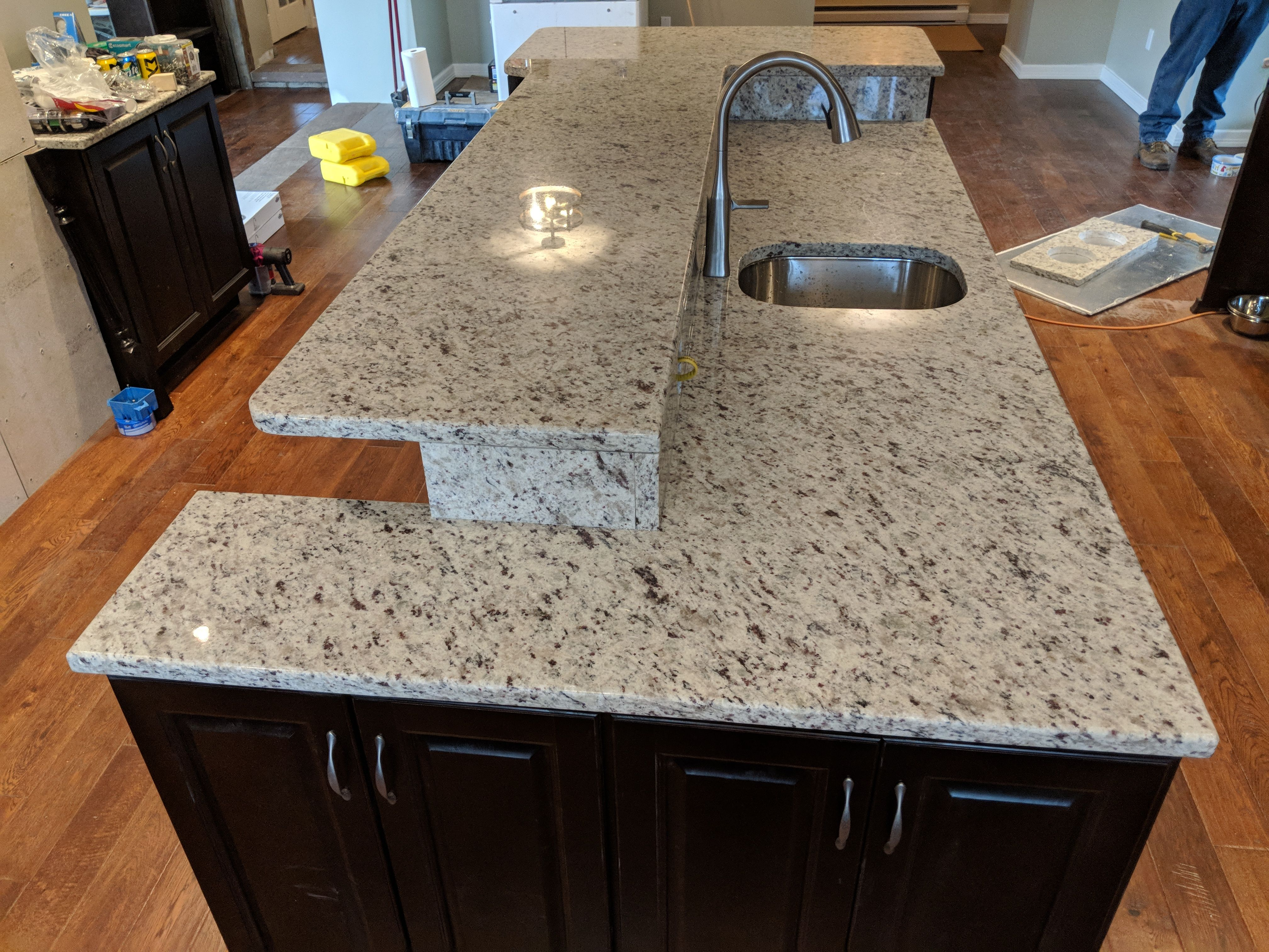 White Ornamental Double Layered Counter Top With Blanco Faucet And Under Mount Sink Installed By M M Granite Til Countertops Granite Countertops Granite Tile