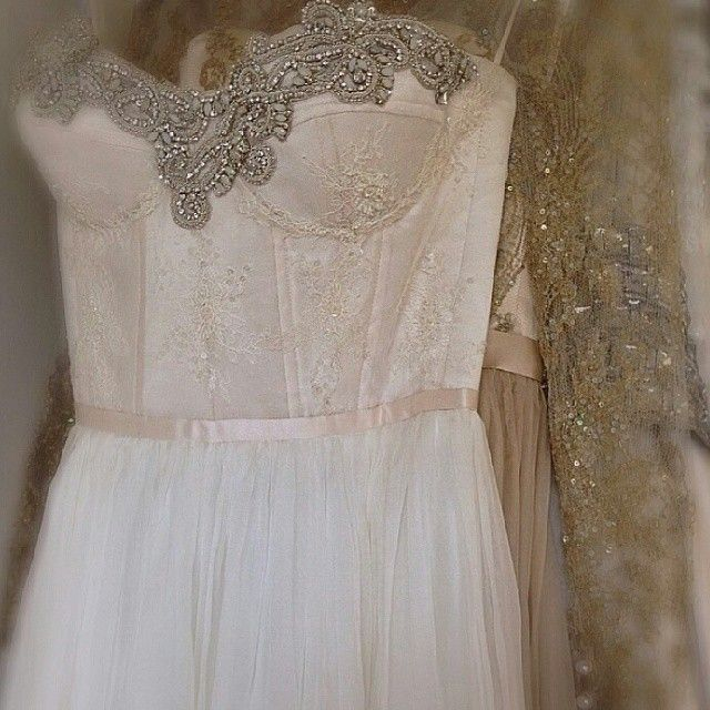 reminds me of the Sandy gown from the Grease revival on Broadway, so simple yet, love the corset look.