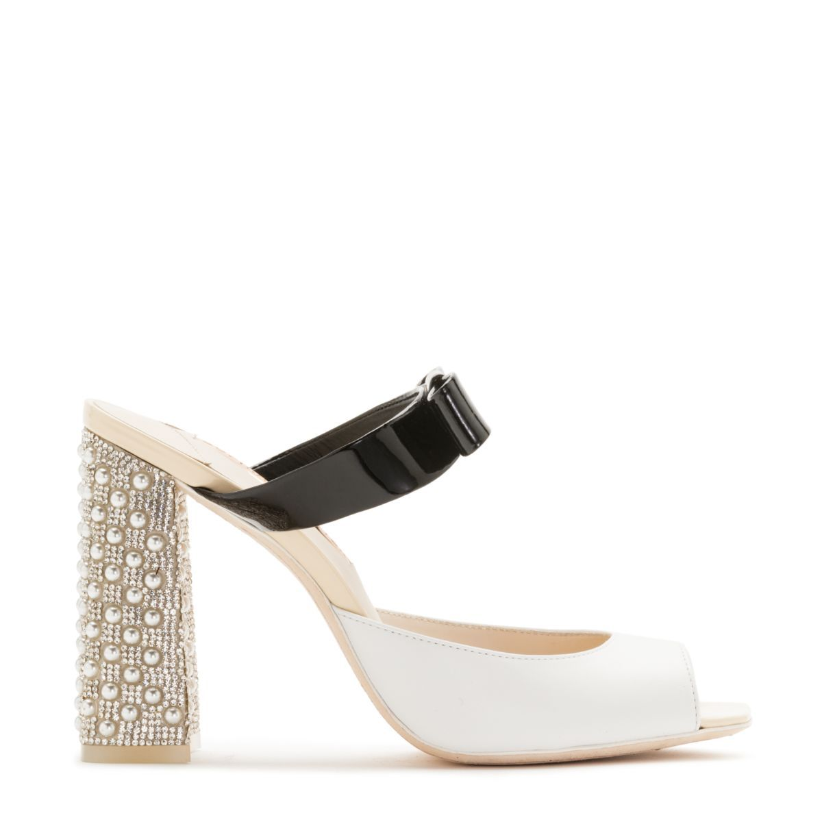 e762f7ee3e95 ANDIE MULE 100MM - Elegant white leather mule with a black patent bow strap  and finished with a pearl and crystal embellished chunky heel.