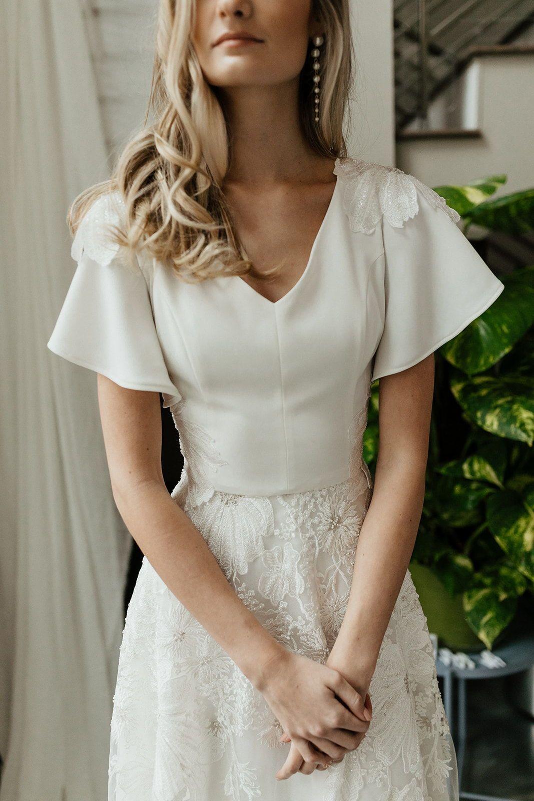 Modest Wedding Dresses That Are As Stylish As You Alta Moda Bridal In 2020 Minimal Wedding Dress Wedding Dresses Wedding Dress Flowy