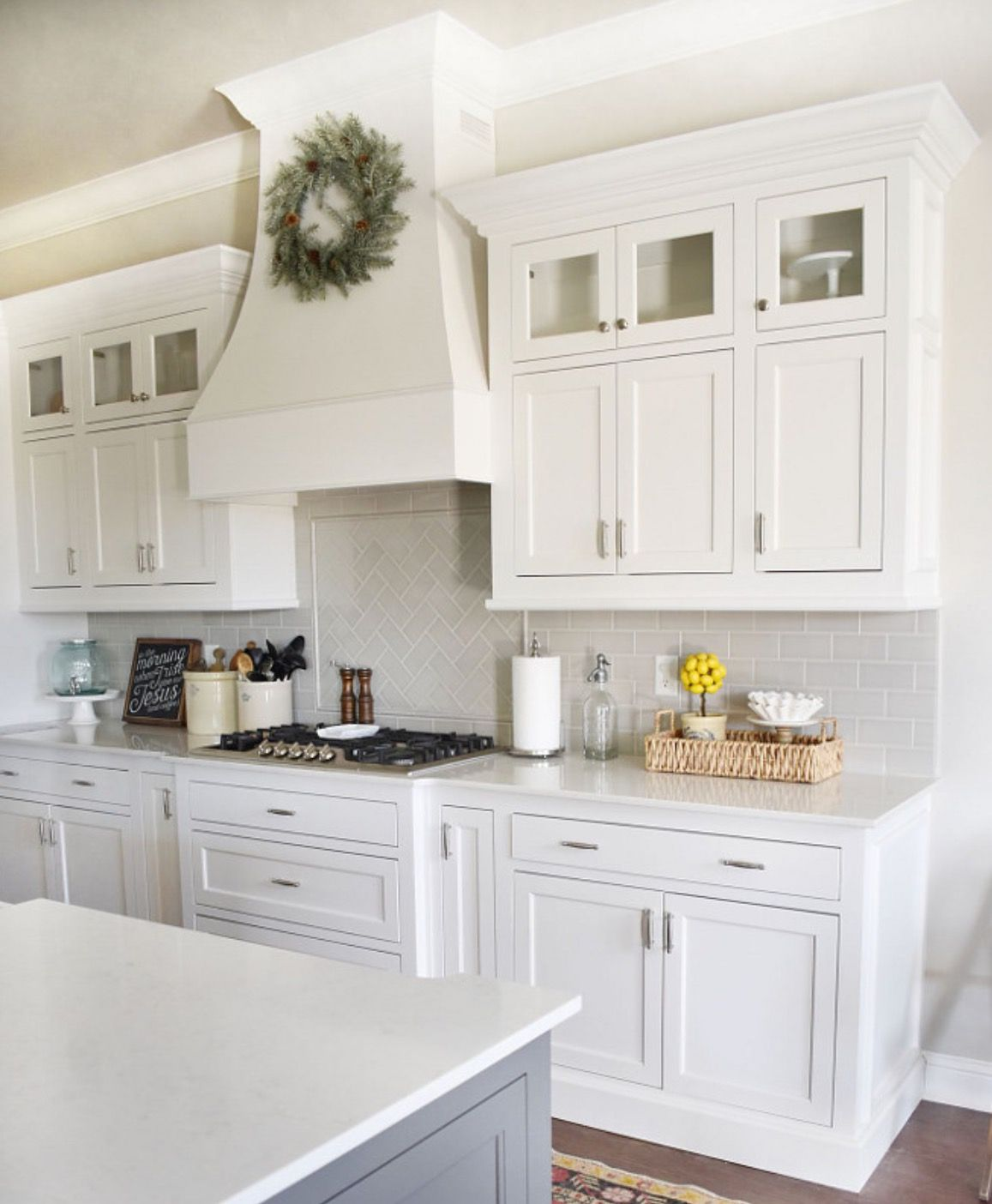 White Kitchen With Glass Inserts In Upper Cabinets