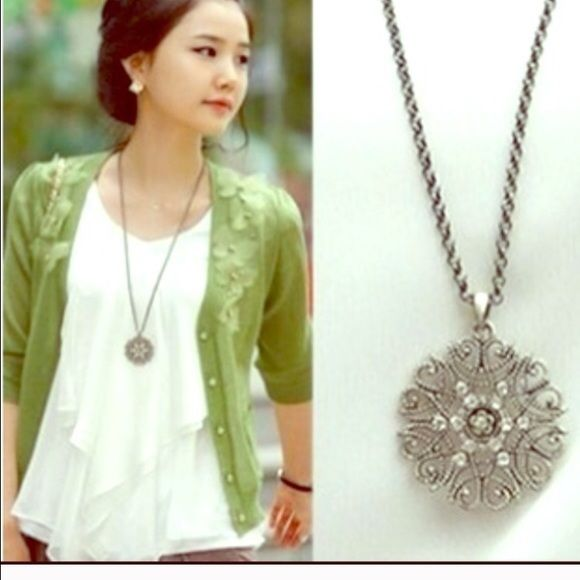 Cute snow flake necklace Very nice silver tone alloy necklace chain is about 26 inches new in package Jewelry Necklaces