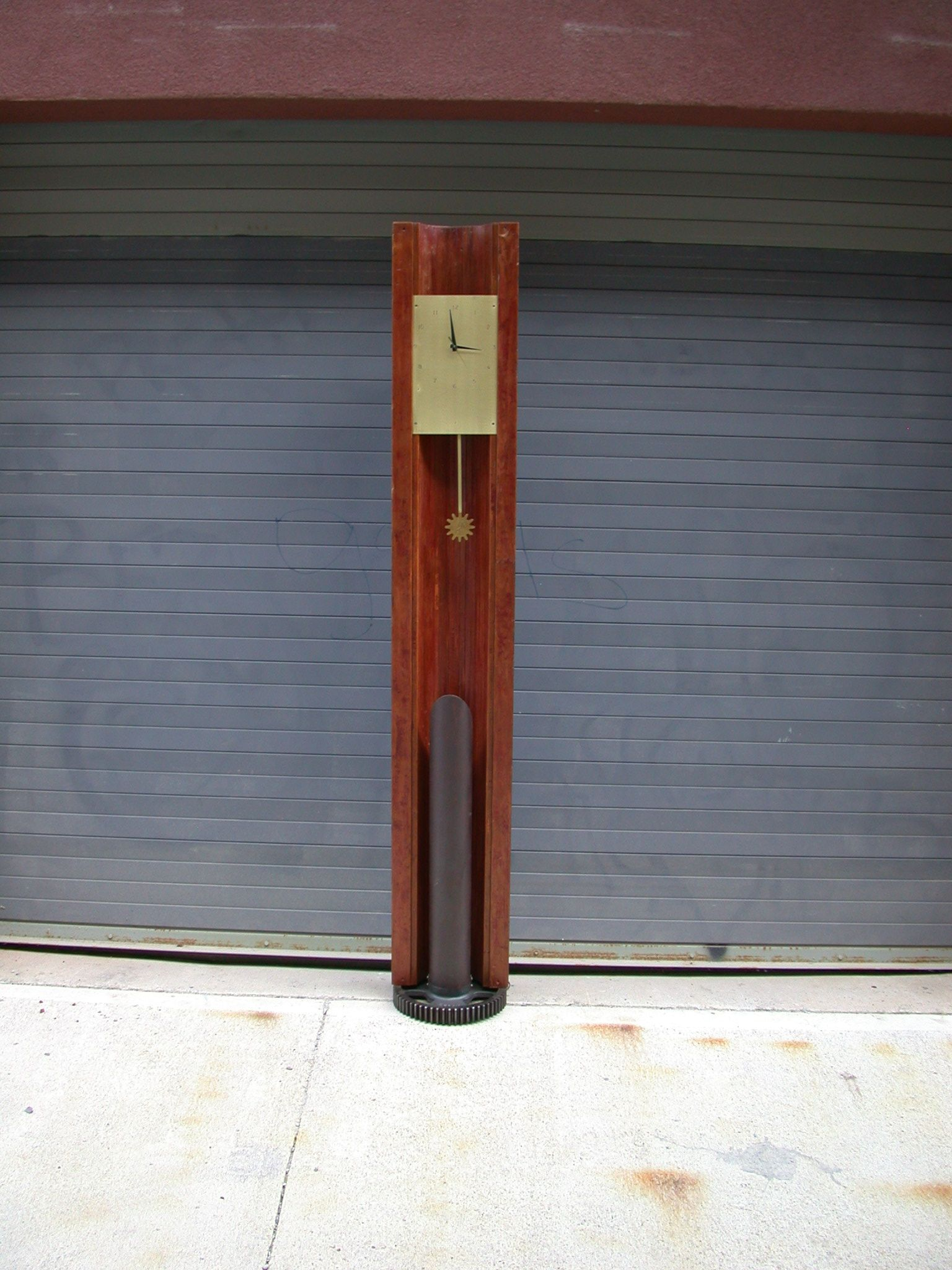 Industrial Modern grandfather clock made with reclaimed wood beams and metal parts. New clock movement