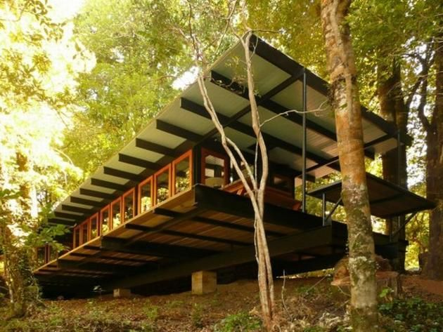 Luxurious House Built from Demolished and Recycled Materials Along the Pirihueico Lake