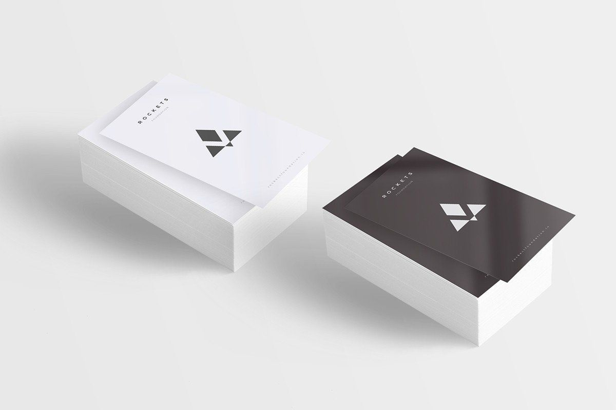 CreativeBooster team has created these mockups by photographing real white business cards in a light tent & CreativeBooster team has created these mockups by photographing ...