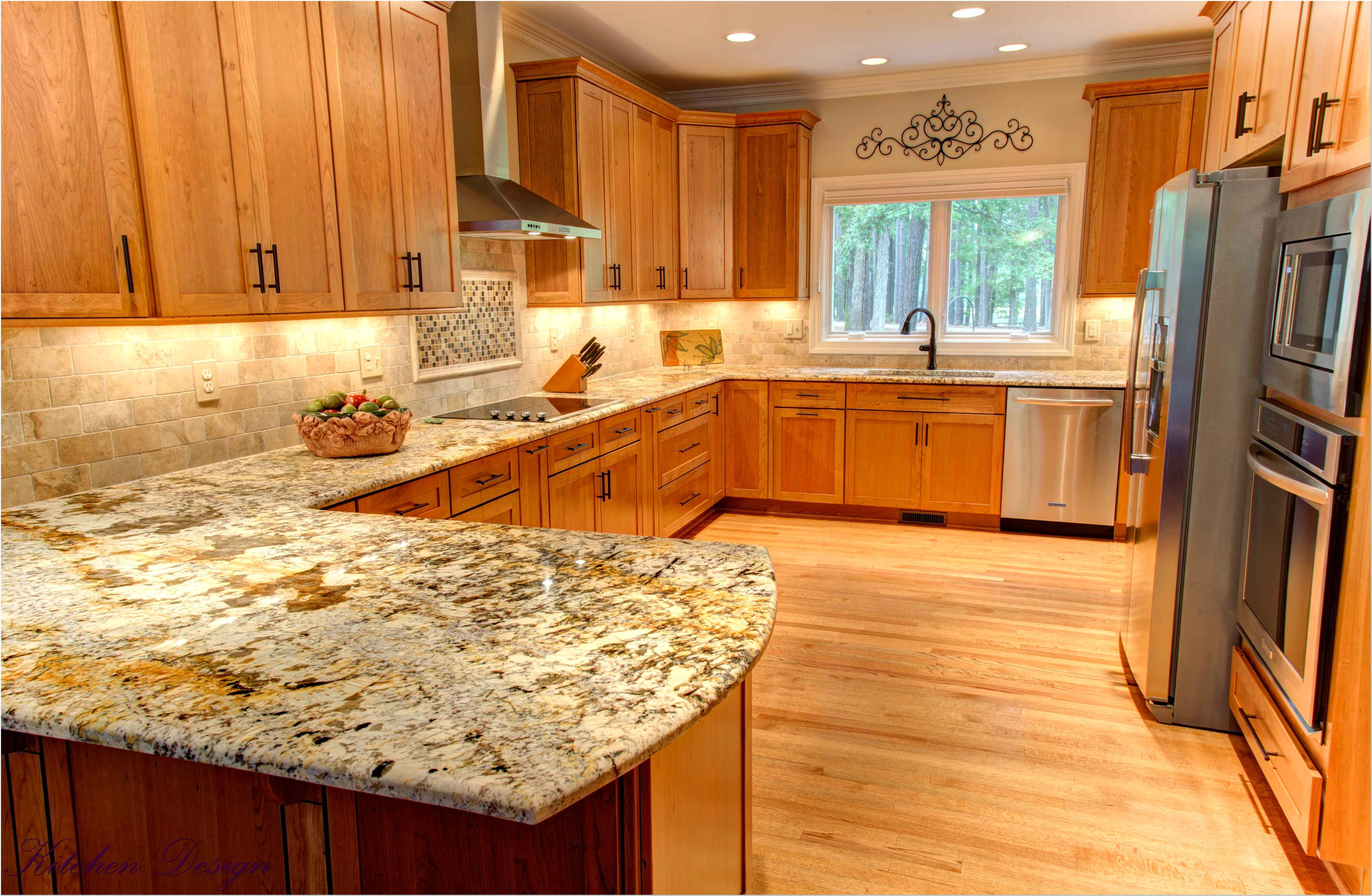 colonial gold granite with maple cabinets | www ... on Pictures Of Granite Countertops With Maple Cabinets  id=36293