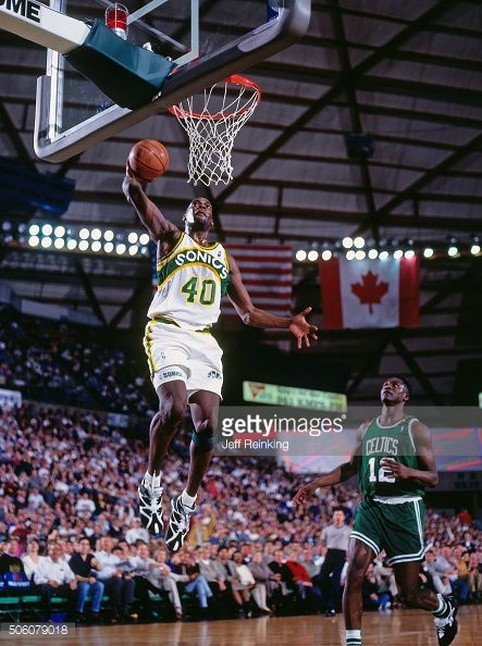 Shawn Kemp of the Seattle Supersonics dunks against the Boston Celtics circa  1995 at Key Arena in Seattle Washington NOTE TO USER User expressly. e4b2ebfd6
