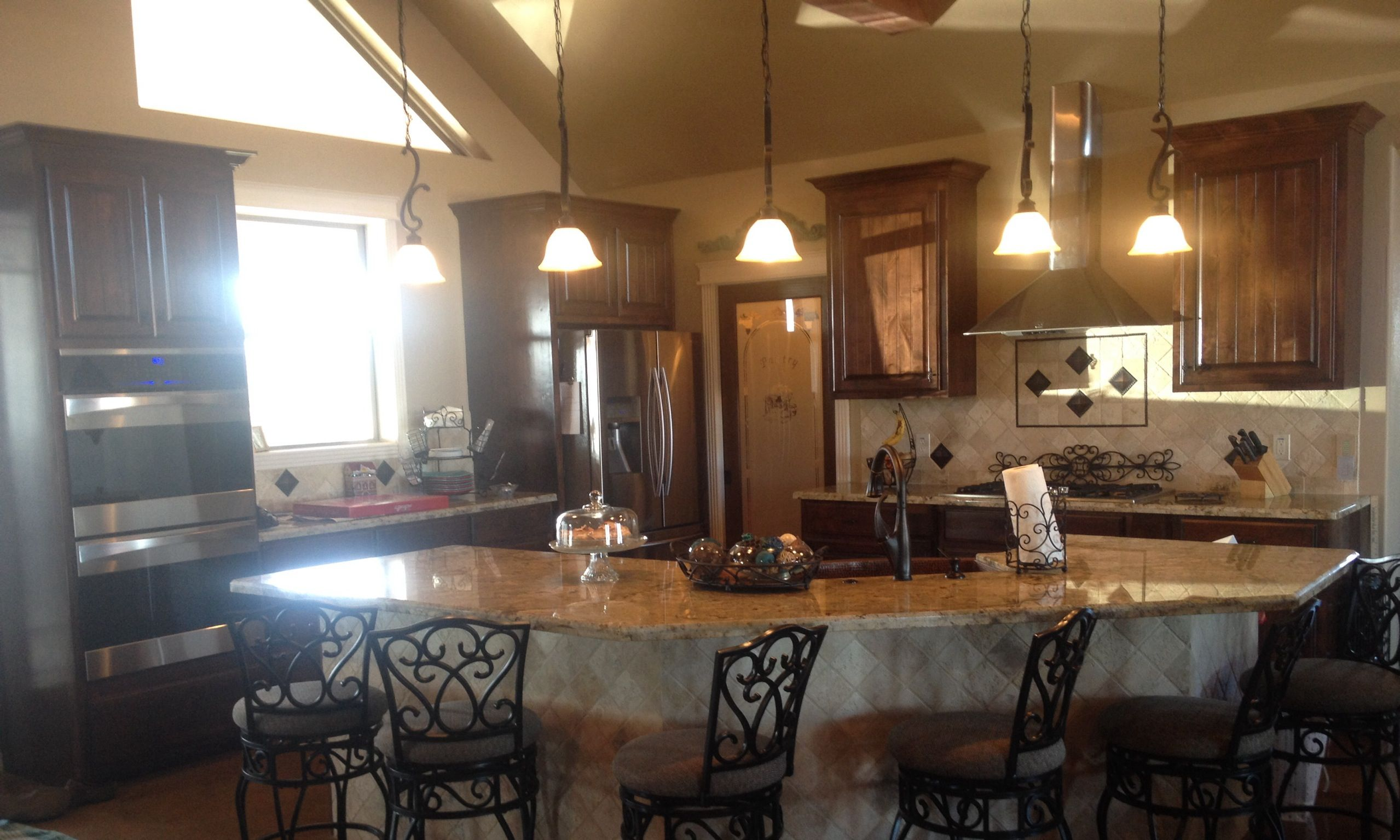 Kitchen open floor plan cathedral ceiling pendant lights glass