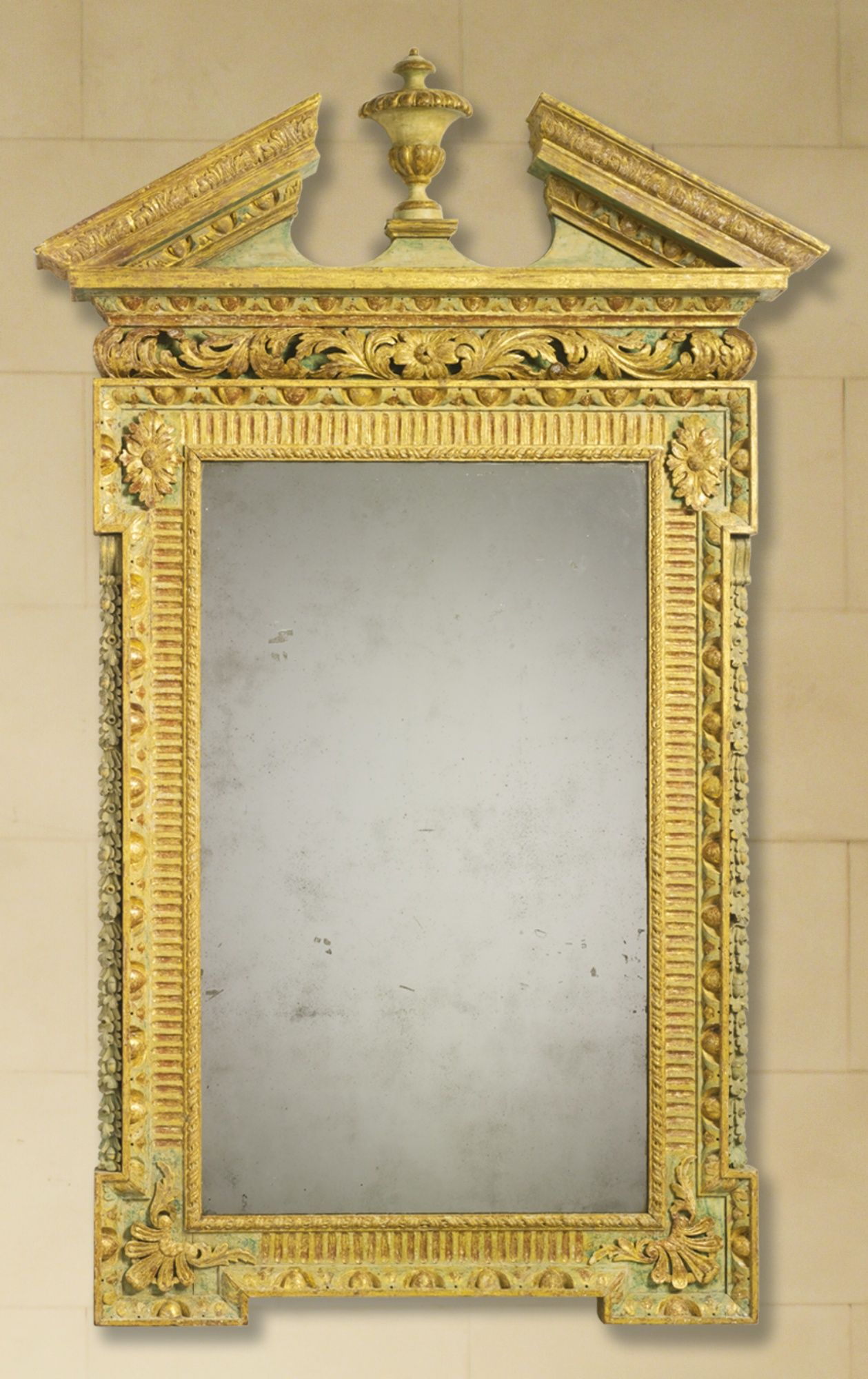 A George II parcel-gilt green-painted pier mirror in the manner of ...