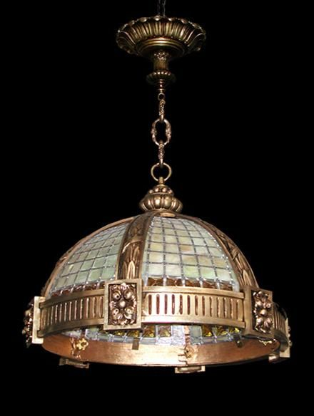 Heavy Bronze hanging light fixture executed in stained glass with ...