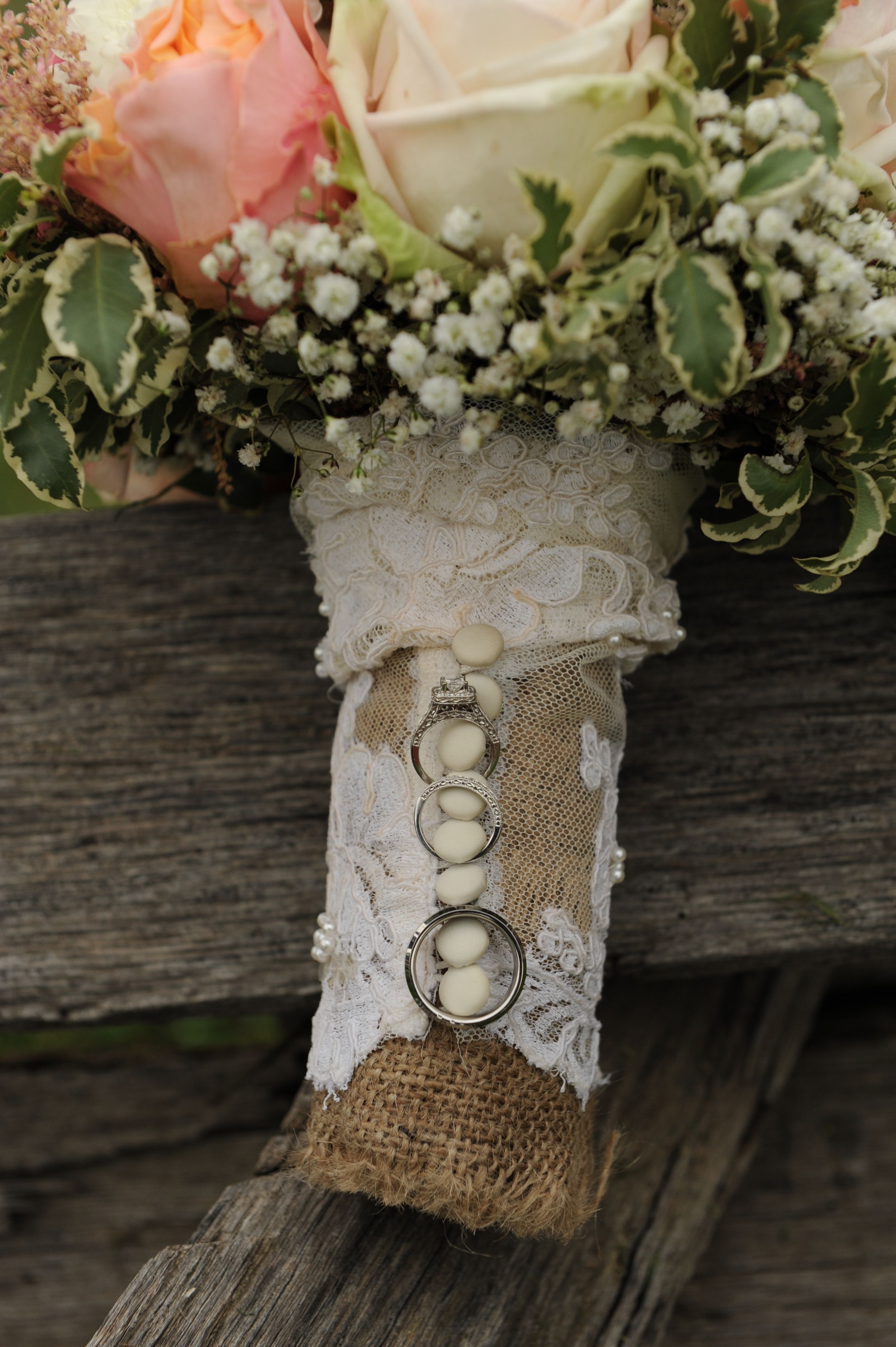 bridal bouquet with handle wrapped with sleeve from mother's