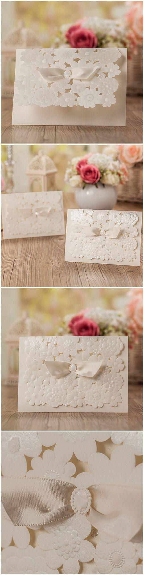 elegant floral laser cut wedding invitations with ribbon