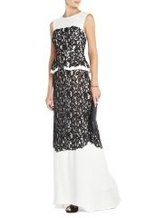 Long black and white dress enriched by black lace.