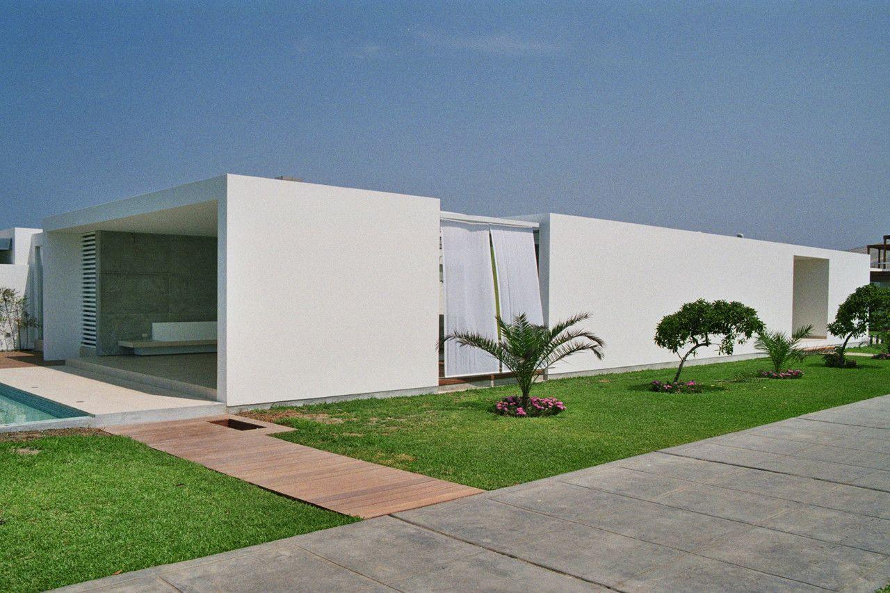 Casa playa el golf a19 rrmr arquitectos casa mia for Casa minimalista harborview hills