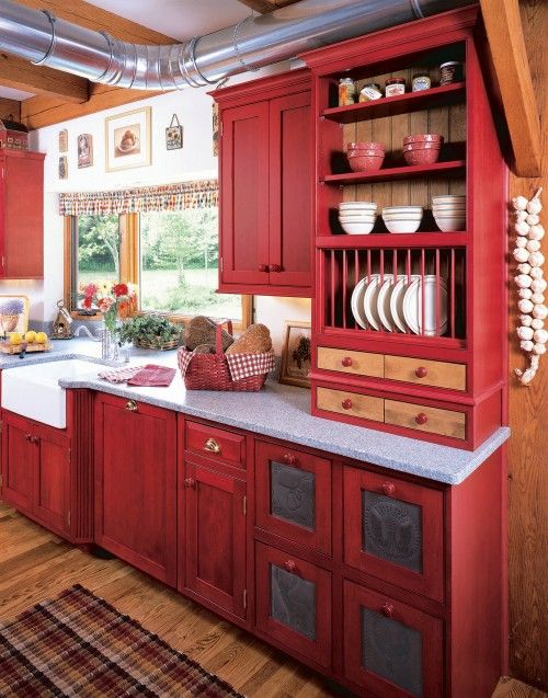 Love the red, and the open plate rack and the punch tin cabinets.
